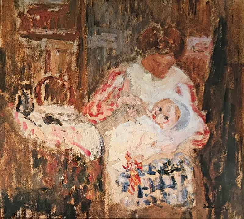 Seated woman in an interior nursing a baby on her lap next to a crib.