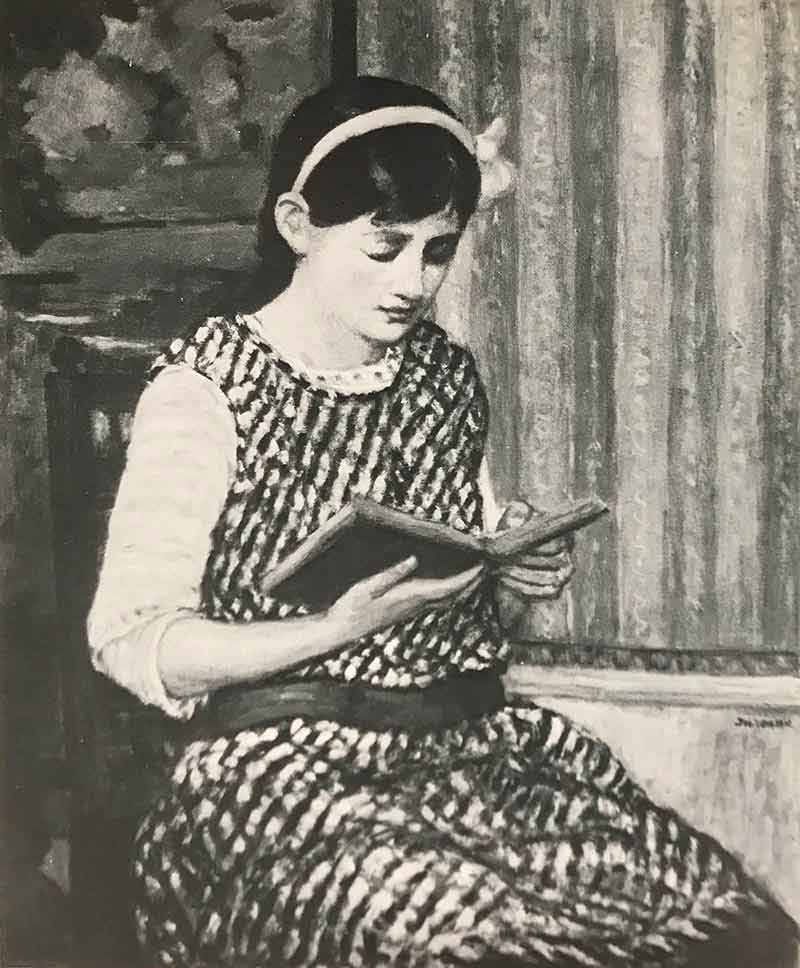 Girl reading a book whilst sitting in room with vertical striped wallpaper and dado rail. The girl is wearing a sleeveless dress and headband with bow.