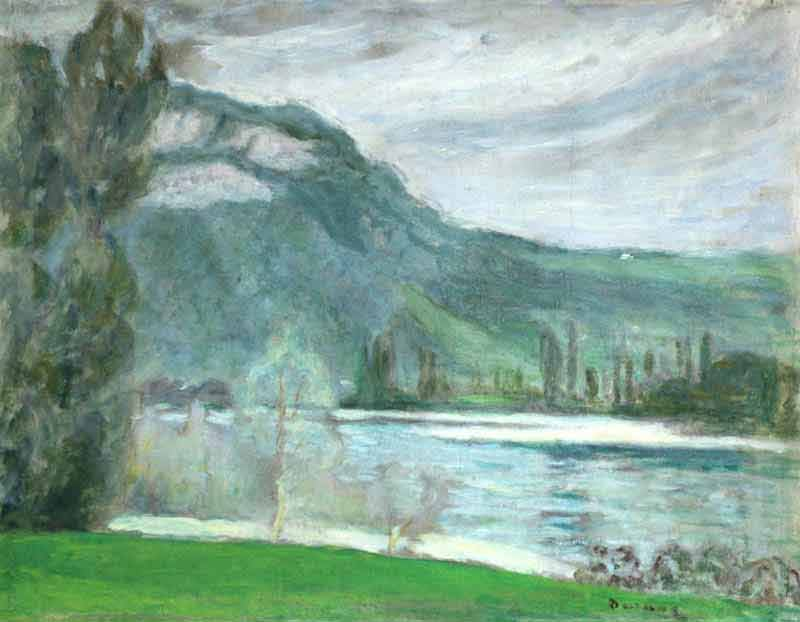 Green riverbank to foreground with tree to left of painting. Far bank and mountains to the distance beneath a cloudy sky.